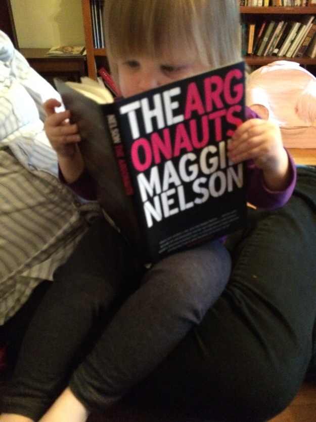 Blonde child reading The Argonauts by Maggie Nelson
